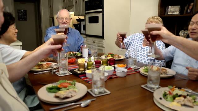 Seniors Toast with Iced Tea at Dinner Table video