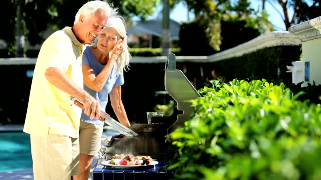 Seniors Using Barbeque Outdoors video