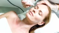 Sensual lady enjoying rejuvenation and hydration therapy video