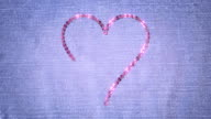 Sequin Love Heart embroidery on denim. Last three seconds loops. video