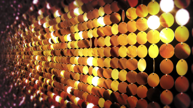 Sequins reflective background. Golden. Sequins catch the light and sparkle. video