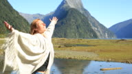 Serene woman relaxes in nature, Milford sound video
