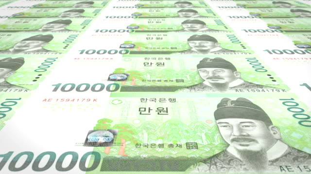 Series of banknotes of ten thousand wons of the bank of the South Korea rolling on screen, coins of the world, cash money, loop video