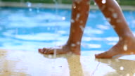 Series of moments of children's feet by the pool side video