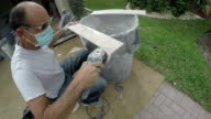 Series: Tile layer uses tool for beveled edge on tile video