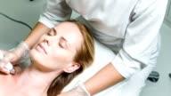 Serine lady enjoying skincare treatment at beauty salon video
