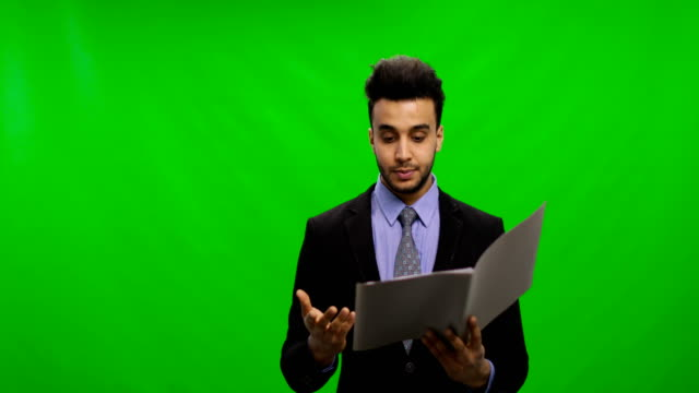 Serious Businessman Read Documents Over Chroma Key Green Screen Hold Reports Pensive Having Problem video