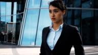 Serious businesswoman walk outdoor video