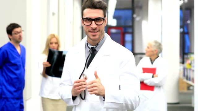 Serious doctor looking at camera video