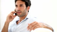 Serious man at phone video