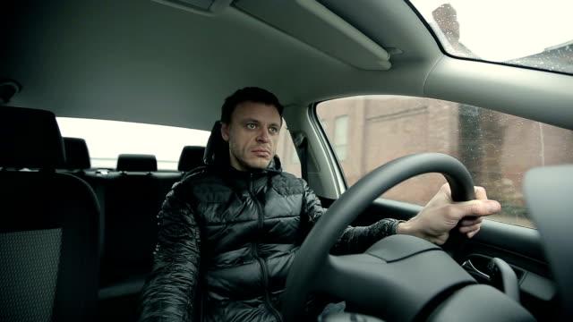 Serious man driving a car video