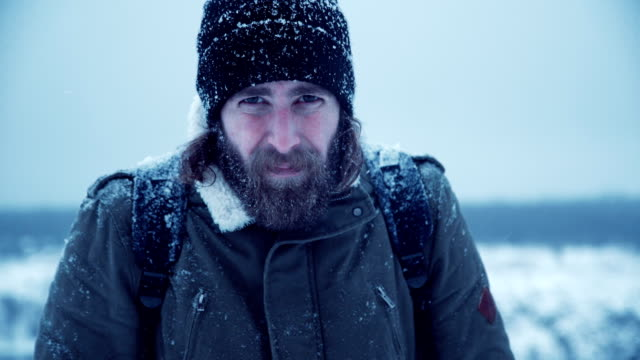 Serious man with beard in snow video