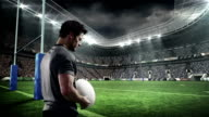 Serious rugby player holding the ball video