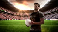 Serious rugby player holds rugby ball video