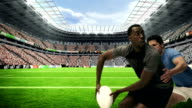 Serious rugby players tackling for ball video