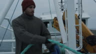 Serious Seaman Pulls the Rope during Traveling on the Ship video