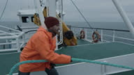Serious Seaman Pulls the Thick Rope during Traveling on the Ship video