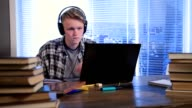 Serious student e-learning online with laptop video