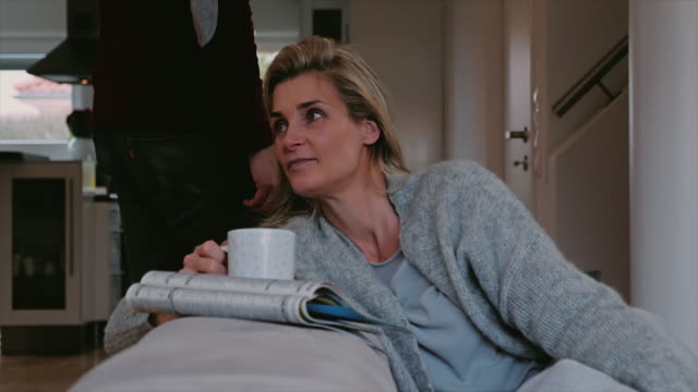 Serious thoughtful woman relaxing with coffee video