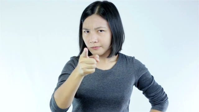 Serious woman pointing at camera on White background video