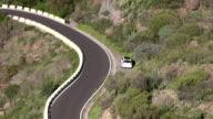 Serpentine road with a white car, near Masca, Tenerife, Spain video