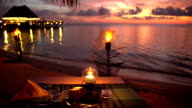 Served tables in the restaurant on the ocean in anticipation of visitors at sunset. video