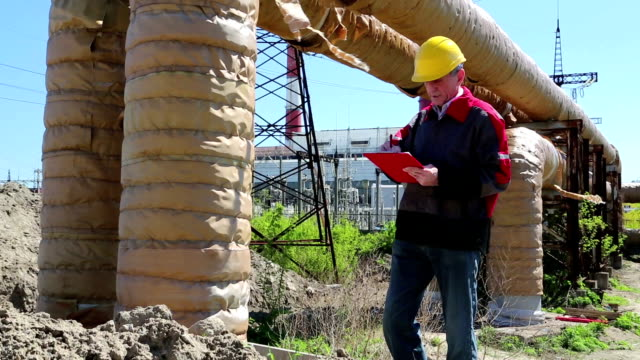 Service engineer at heat electropower station video