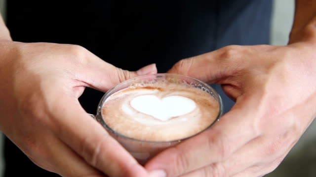 Serving  a cup of art latte at coffee shop, shape of a heart video