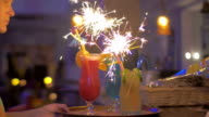 Serving Cocktail Glasses with Sparklers in Them video