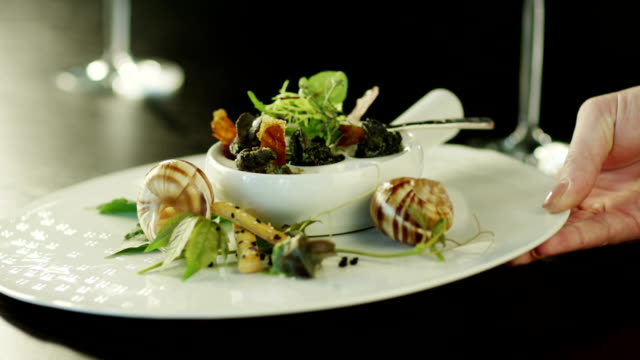 Serving Delicious Baked Escargots in Luxury Restaurant. Close-Up. video
