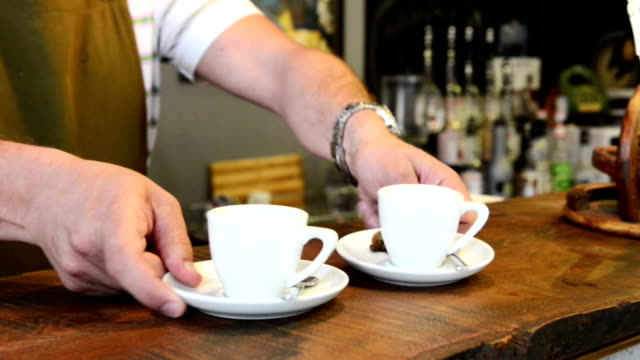 Serving espresso in a coffee shop video