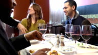Serving Meal in Busy Restaurant video