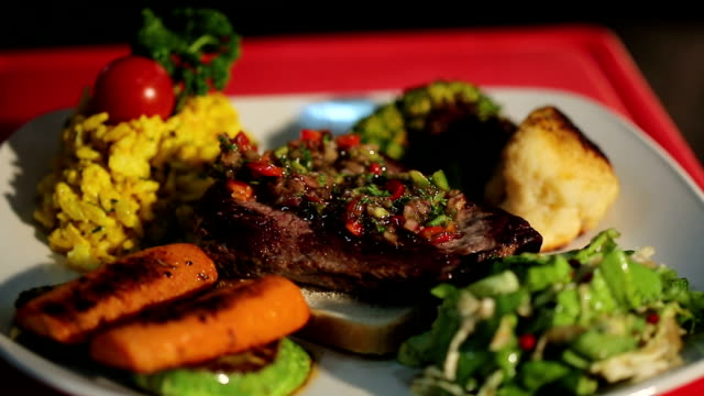 Serving of grilled beef steak with vegetables video