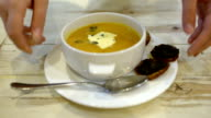 Serving of soup with bruschetta in cafe or restaurant video