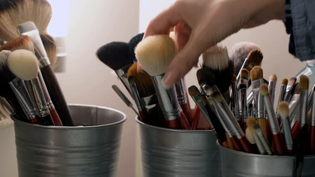 Set of cosmetic brushes. Makeup brushes in a bucket video