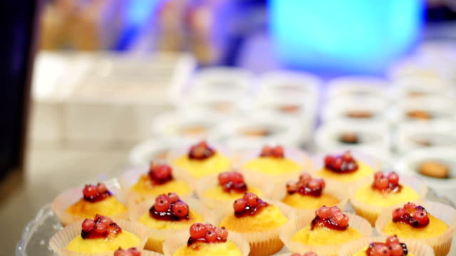 Set of cute cakes under glass dome video