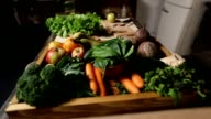 Set of fresh vegetables and fruits on wooden tray video