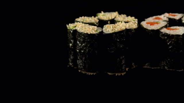 Set of Maki sushi on a black surface close-up. video