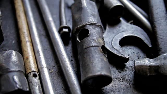 A set of old metal repair tools video