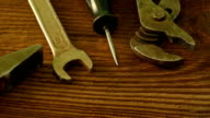 Set of old tools to repair on a wooden surface: hammer, pliers, wrench, screwdriver, scissors video