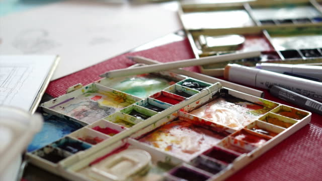 Setting of table and painting equipments of watercolours, palette, colour, brush, paper video