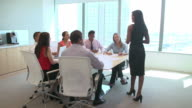 Seven Businesspeople Having Meeting Around Boardroom Table video