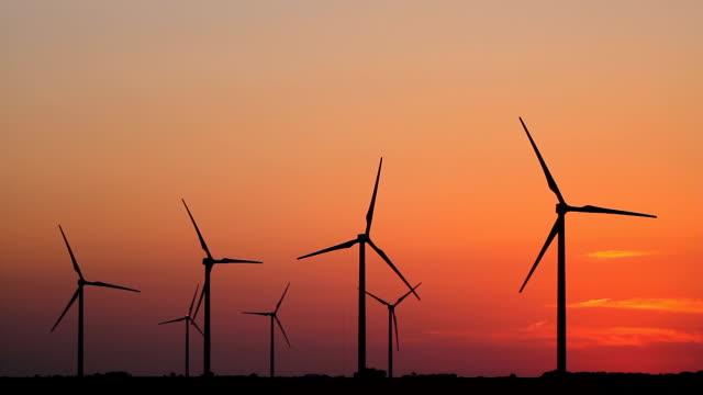 Seven Wind Turbines At Sunset video