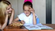 Seven-year school girl eating homemade liver tells mom about homework video