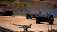 Several BMP moving on the range on military exercises video