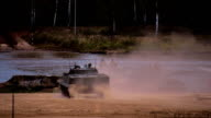 Several BMP moving to the river to cross the river by swimming video