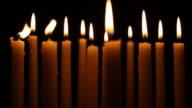 Several Candles lined up over Black Background video