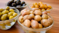 Several kinds of olives in glass bowls video