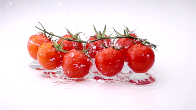 A Several Ripe Tomatoes are Falling on the Table. video