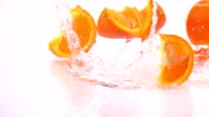 A Several Slices of Orange are Falling on the Table. video